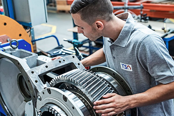 TSA employee during repair work on traction motor
