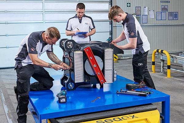 TSA employees during series testing of electric motor